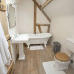 Luxurious double ended Victorian style cast iron bath, Walk in shower.