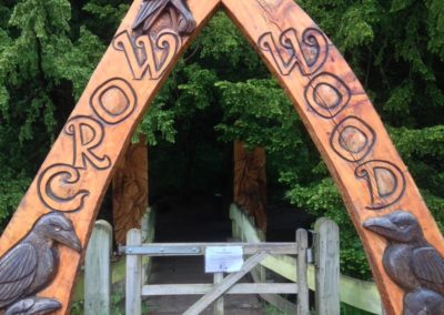 Entering Crow Wood under the carved archway