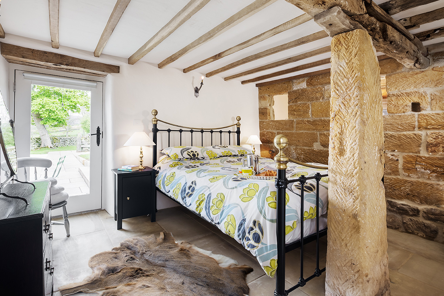 characterful ground floor bedroom Ground floor bedroom with a door leading straight out onto the terraced garden